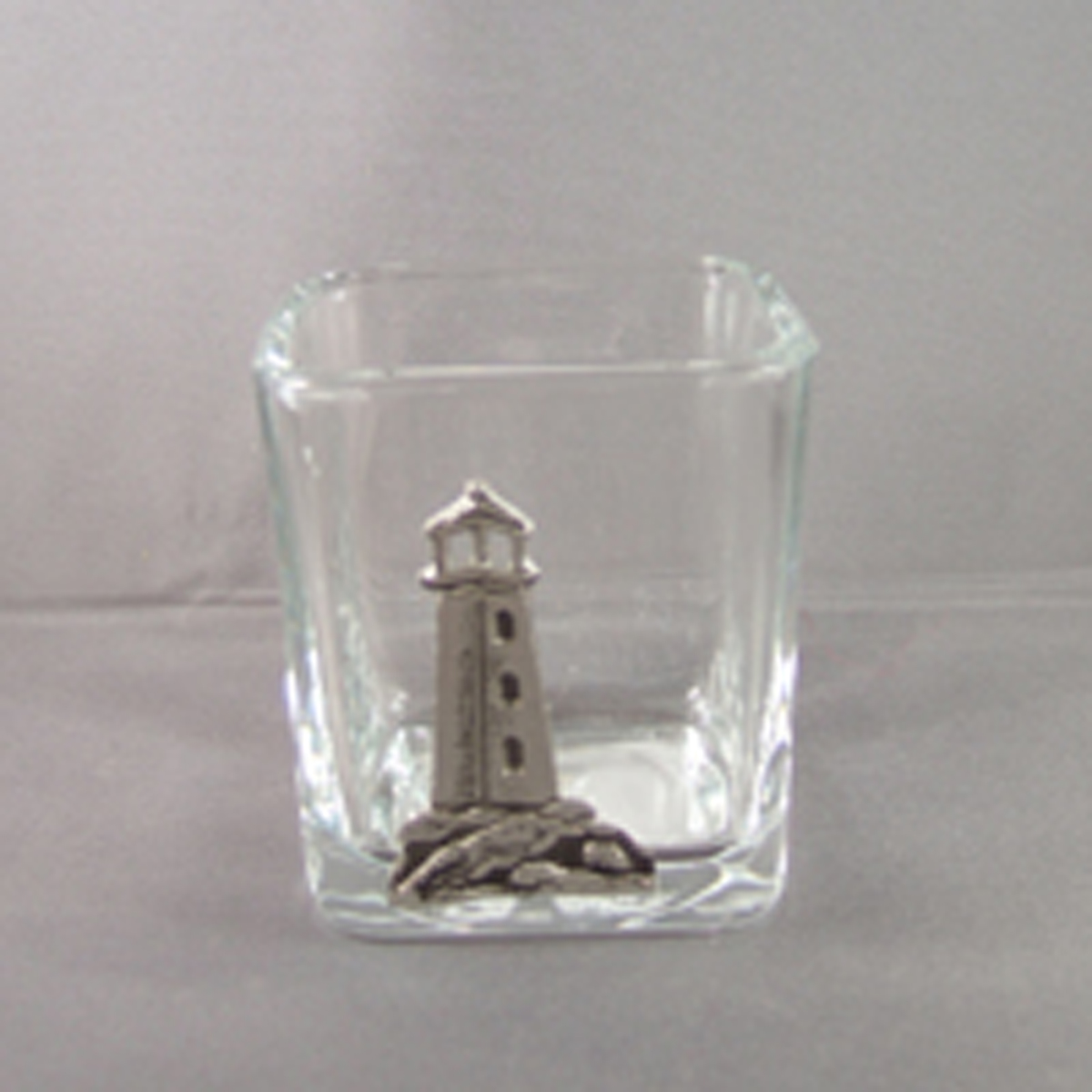 Glass votive holder with pewter